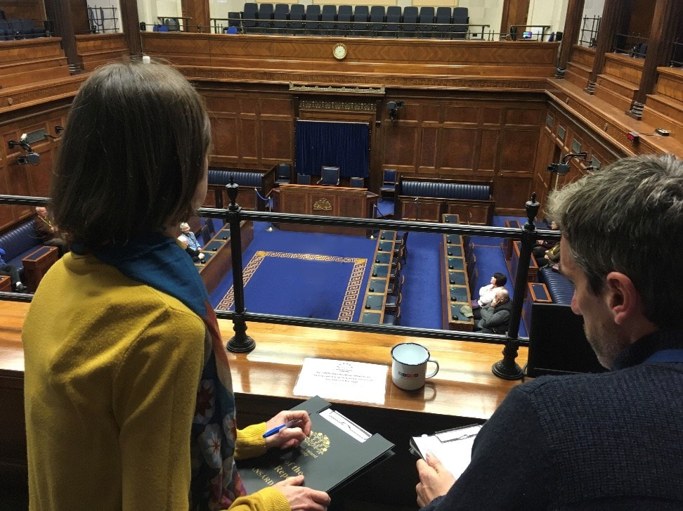 Reporters in the Northern Ireland Assembly chamber